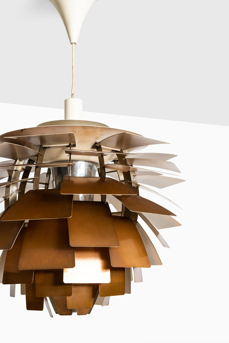 Rare first edition artichoke ceiling lamp designed by Poul Henningsen. Produced by Louis Poulsen in Denmark.
