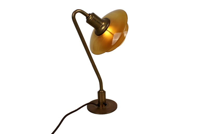 """Poul Henningsen, 'Snowdrop' desk lamp, model 2/2 in brass with amber colored glass shades. This model manufactured 1931–1933 by Louis Poulsen, Denmark. Stamped 'PH2 PATENTED'.  Literature: """"Light Years Ahead"""", ill. p. 164."""
