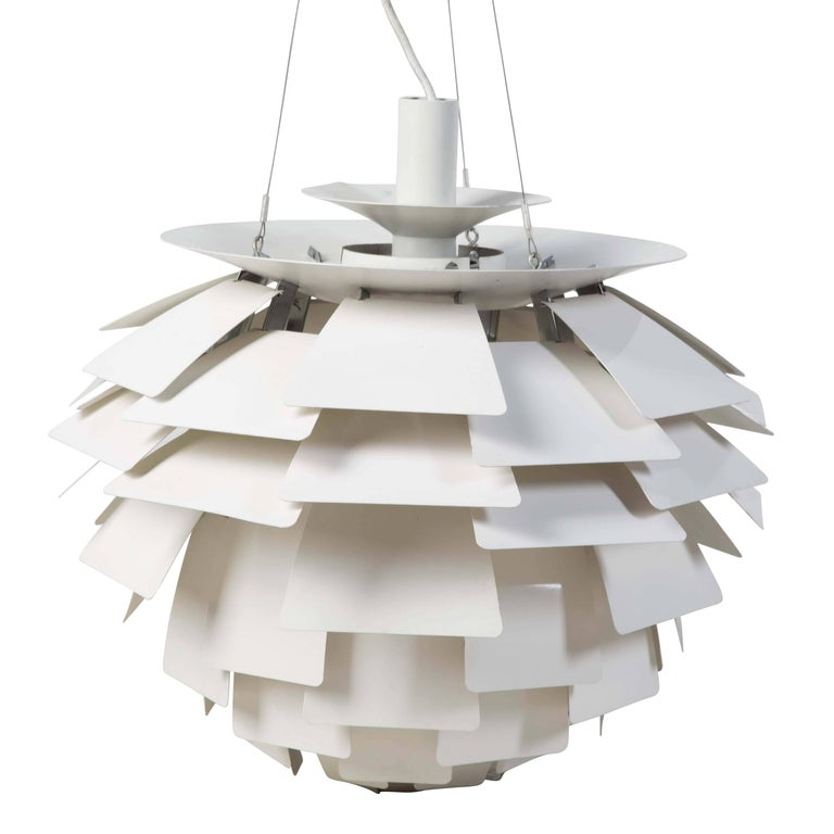 A design icon dating from 1958, the PH Artichoke pendant light has 72 leaves in 12 circular rows, allowing the light to be viewed from any angle with out being able to see the light source. Designed in Denmark by Poul Henningsen for Louis Poulsen.
