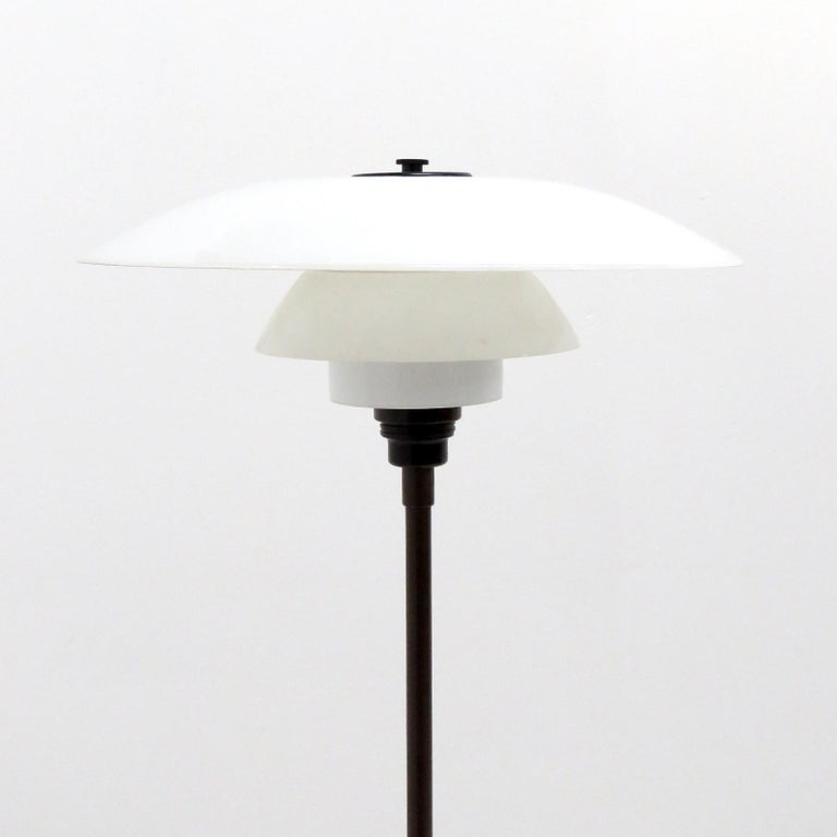 Rare, early floor lamp by Poul Henningsen for Louis Poulsen with two layer opaline glass PH 4/3 shade set, bakelite socket and cover plate. The lamp is wired for US standards with brown cloth cord and a foot switch, one E27 socket, max. Wattage 100w
