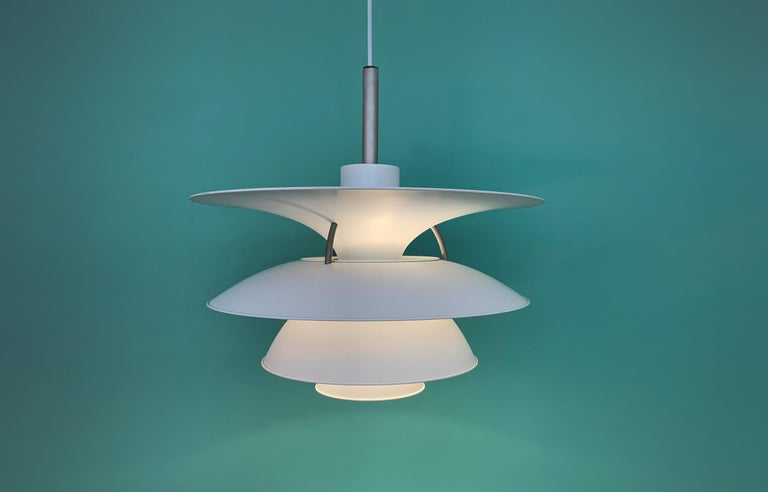 Wonderful pendant lamp designed by Poul Henningsen. Produced by Louis Poulsen Denmark.  New white 2.5 m fabric cord.   Mid-Century Modern Classic design.  Perfect original condition with minor wear consistent with age and use.