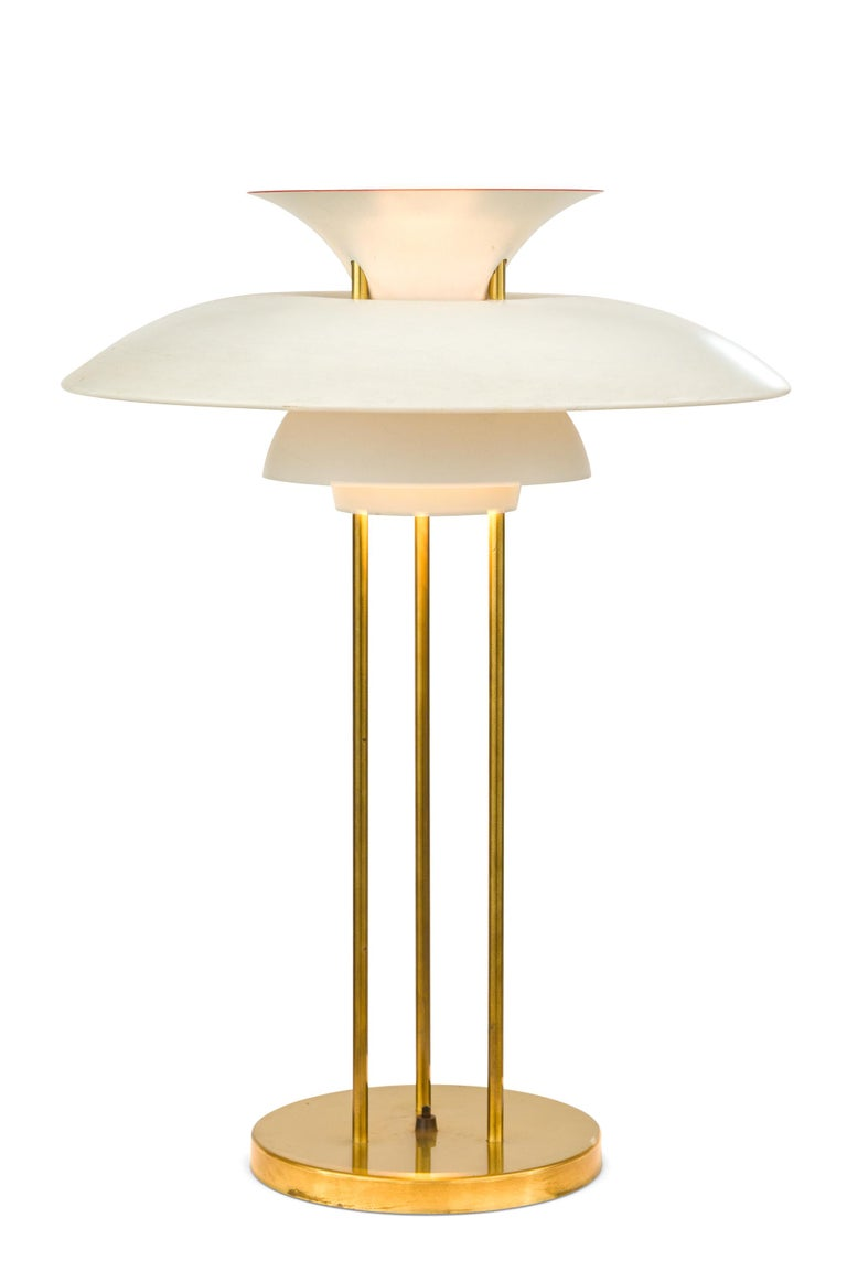 Unlike the Classic PH 3/4 table lamps this pair of lamps are supported by three vertical support rods rather than one. The shades are enameled aluminum and the support rods are brass. Sold as a pair or individually.