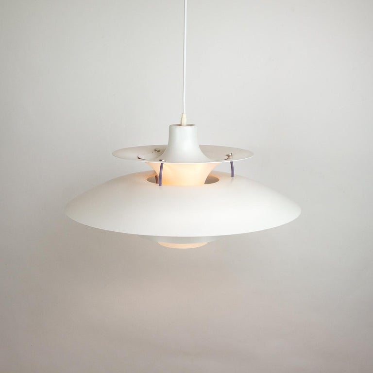 Designed by Poul Henningsen for Louis Poulsen in 1958. The PH5 is designed to be hung low over a table and disperses the light in a non-glare manner. Excellent vintage condition, Denmark, 1960s-1970s. We have 2 available in white.