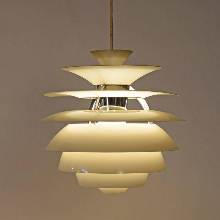 White enamel painted metal shades in ring form with polished chrome ribs and socket housing. Retains paper label. Made by Louis Poulsen. Diffused lighting - can take up to 300 watt bulb.