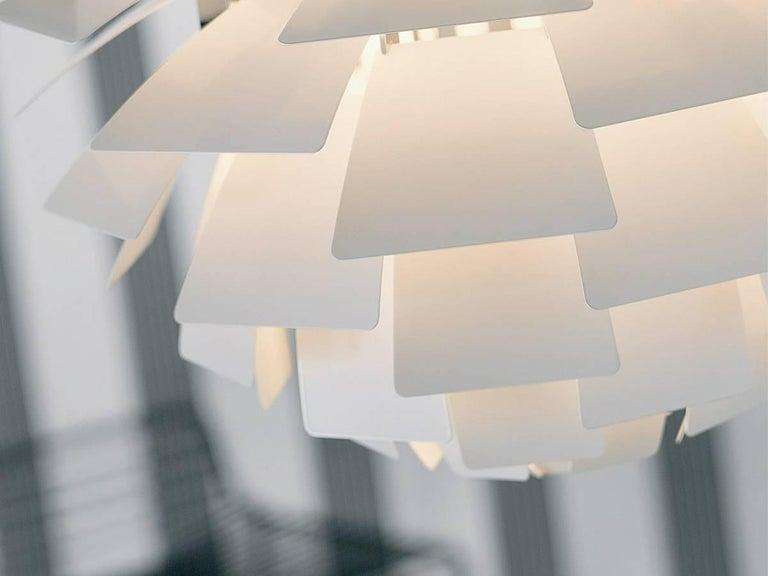 Poul Henningsen White PH Artichoke large chandelier for Louis Poulsen. The PH Artichoke pendant light was designed in 1958 by Poul Henningsen for the Langelinie Pavillonen restaurant in Copenhagen, where it still hangs today.   Largest model white