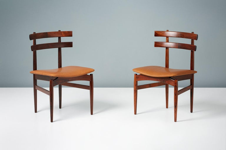 Rarely seen set of six sculptural Brazilian rosewood dining chairs by Poul Hundevad. The seats have been newly upholstered in aniline cognac brown leather. Manufactured by Poul Hundevad in Vamdrup, Denmark, circa 1958.