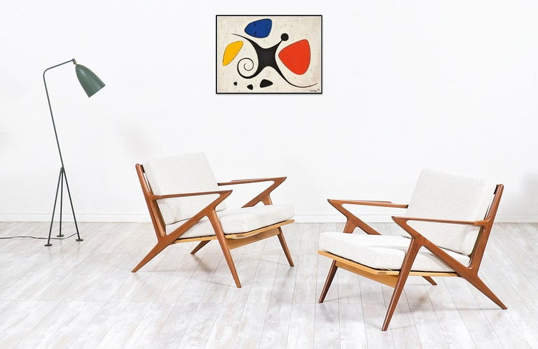 A must-have pair of iconic modern lounge chairs! Designed by the famous architect Poul Jensen and produced by the renowned company Selig in Denmark circa 1960s. This spectacular design is known as the