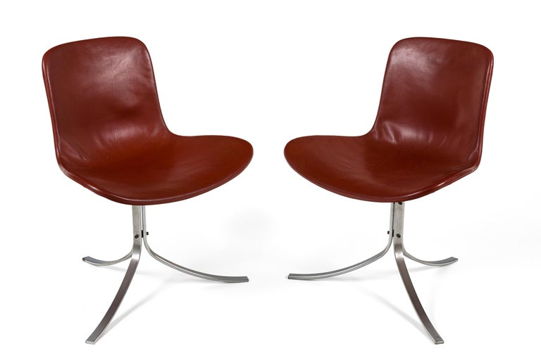 A pair of PK 9 chairs in very good condition, upholstered in brown leather with chromed steel frames. Marked with E. Kold Christensen's logo.