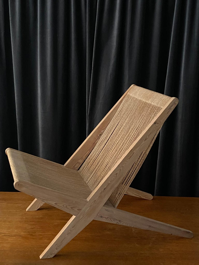 A hyper modern and Minimalist lounge chair attributed Poul Kjaerholm & Jørgen Høj for Thorald Madsen Snedkeri, designed in 1953. 