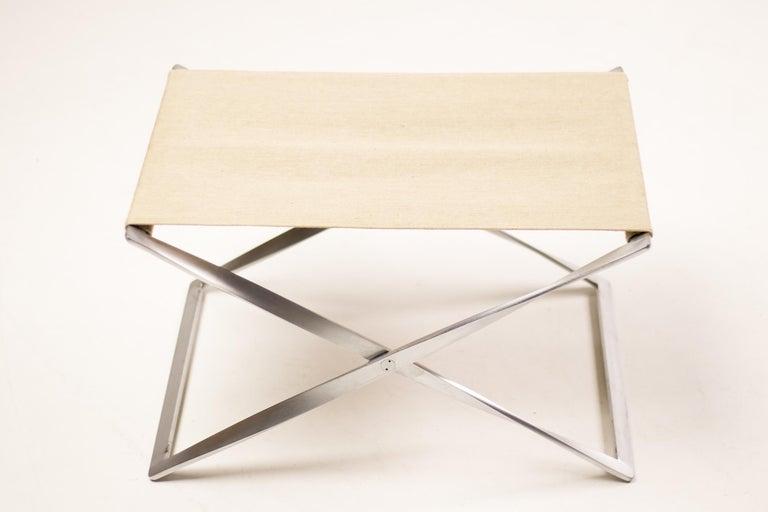 PK91 folding stool in canvas by Poul Kjærholm. Designed in 1961.  Manufactured by E. Kold Christensen A/S, Copenhagen, Denmark.