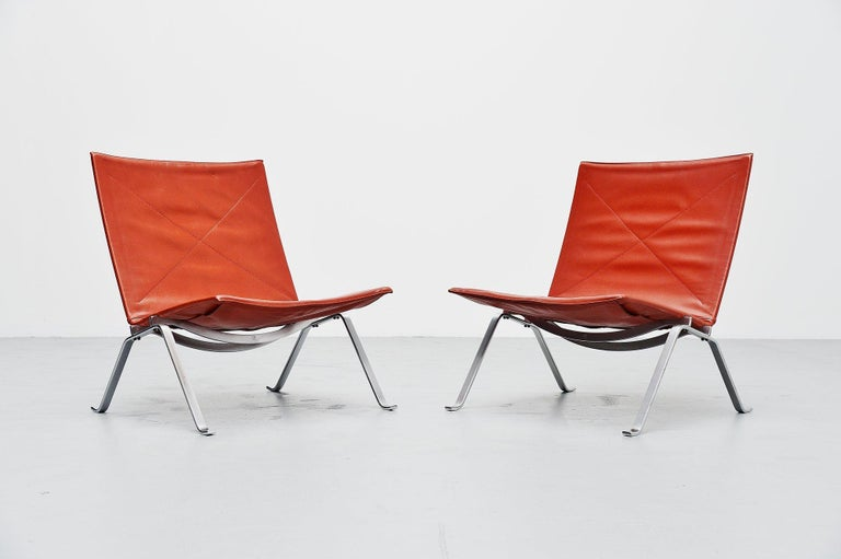 This is for the famous pair of PK22 chairs designed by Poul Kjaerholm for E Kold Christensen, Denmark, 1956. These chairs are early editions with very nice and rare oxblood leather. The chairs consisted of a spring steel structure, one pair each of
