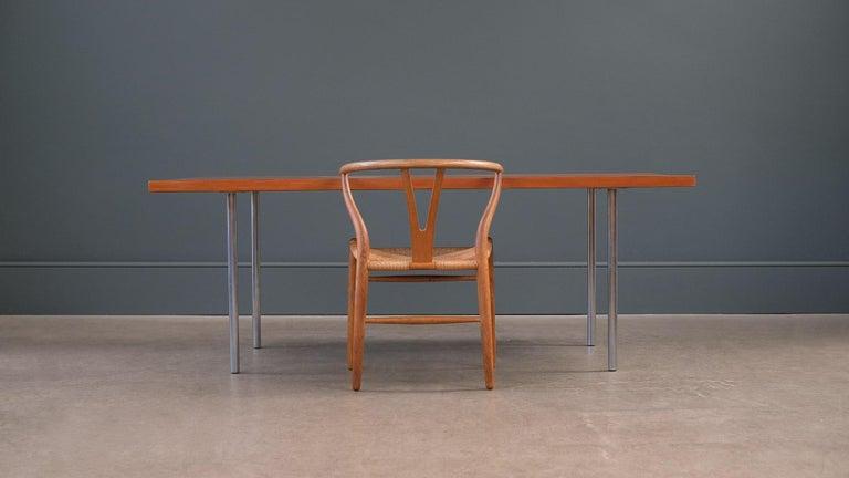 Fantastic work table model PK 41 in Oregon pine and steel designed byPoul Kjærholm for E Kold Christensen, Denmark. Ultra minimal and elegant table.
