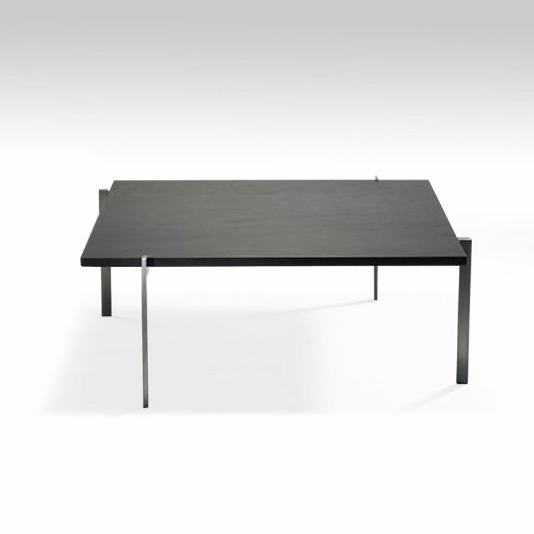 A square coffee table with a slate top on a four legs matte chrome-plated steel stand, 