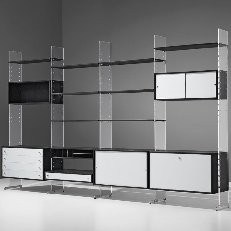 Poul Nørreklit for Selectform, free-standing cabinet, black lacquered wood, aluminum and plexiglas, Denmark, late 1960s  A substantial and functional storage system consisting of various cabinets, drawers and multiple shelves. These can be