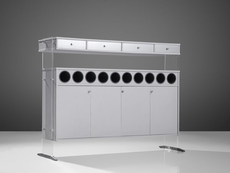 Poul Nørreklit drybar, formica, metal, Denmark, circa 1969.  Nørreklit is known for the use of transparent, unconventional materials and a clear visual language as reflected in this dry bar. The free-standing bar is executed with white laminate