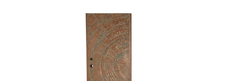 ByForms and Surfaces circa 1960-1970, a textured, bonded and poured bronze door in an abstract Sunburst design. An absolutely stunning and eye-catching door, this item comes from deadstock and has never been used, so it is in excellent condition