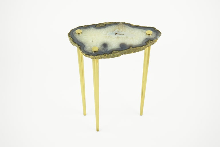 Zoom in and get lost in the beauty of these high-polished natural quartz crystal table tops pierced by solid brass legs. The 'Powers of 10' Tables are durable, heavy, and one-of-a-kind. Each one has a unique shape and other worldly color palette.