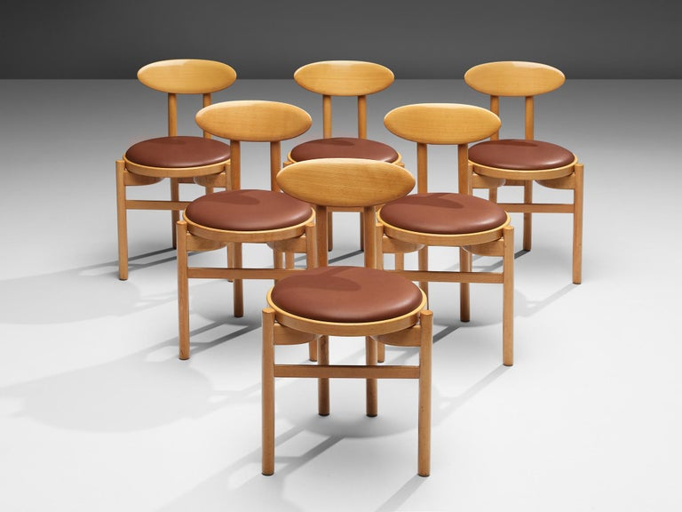Pozzi, dining chairs, beech, leatherette, Italy, 1970s  With their round seats and oval backrests these dining chairs by Italian manufacturer Pozzi have a dynamic, almost playful appearance. Two round legs in front and two paired legs in the back