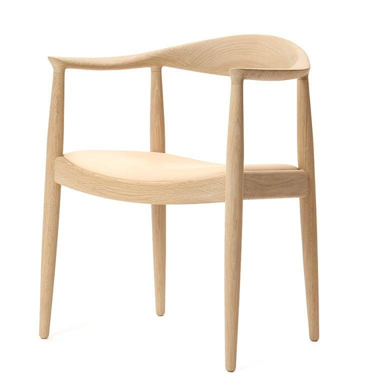 The PP503 round chair in soap-treated oak with sculpted back and arms having an upholstered seat in natural leather. Each round chair is made to order and takes between 16-24 weeks to produce. Available in oak, ash, cherry or wengé in soap, oil or