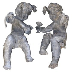 Pair of 19th Century Cast Lead Cupids from a Municipal Fountain