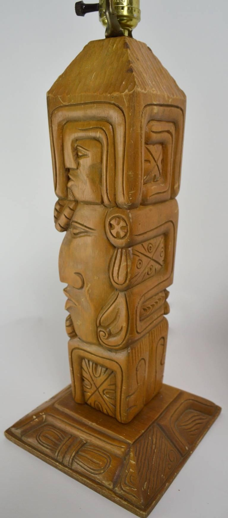 Pair of carved wood tiki, or Aztec style TOTEM lamps. Fun, funky and chic, working original condition, selling without shades, or harps. Dimension as follows: