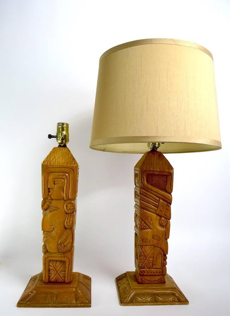 20th Century Pair of Aztec Motif Carved Wood Tiki Lamps For Sale