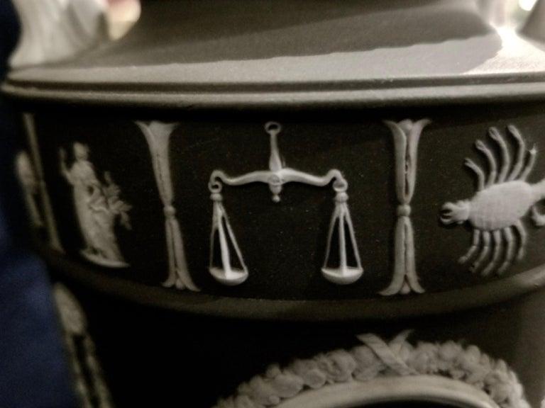 Pair of English Jasperware Lidded Black-Ground Wedgwood Vases with Zodiac Panels For Sale 4