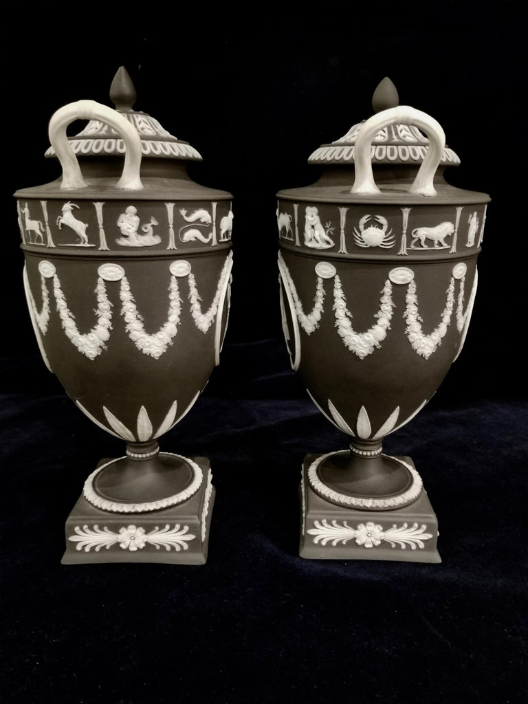 Neoclassical Pair of English Jasperware Lidded Black-Ground Wedgwood Vases with Zodiac Panels For Sale