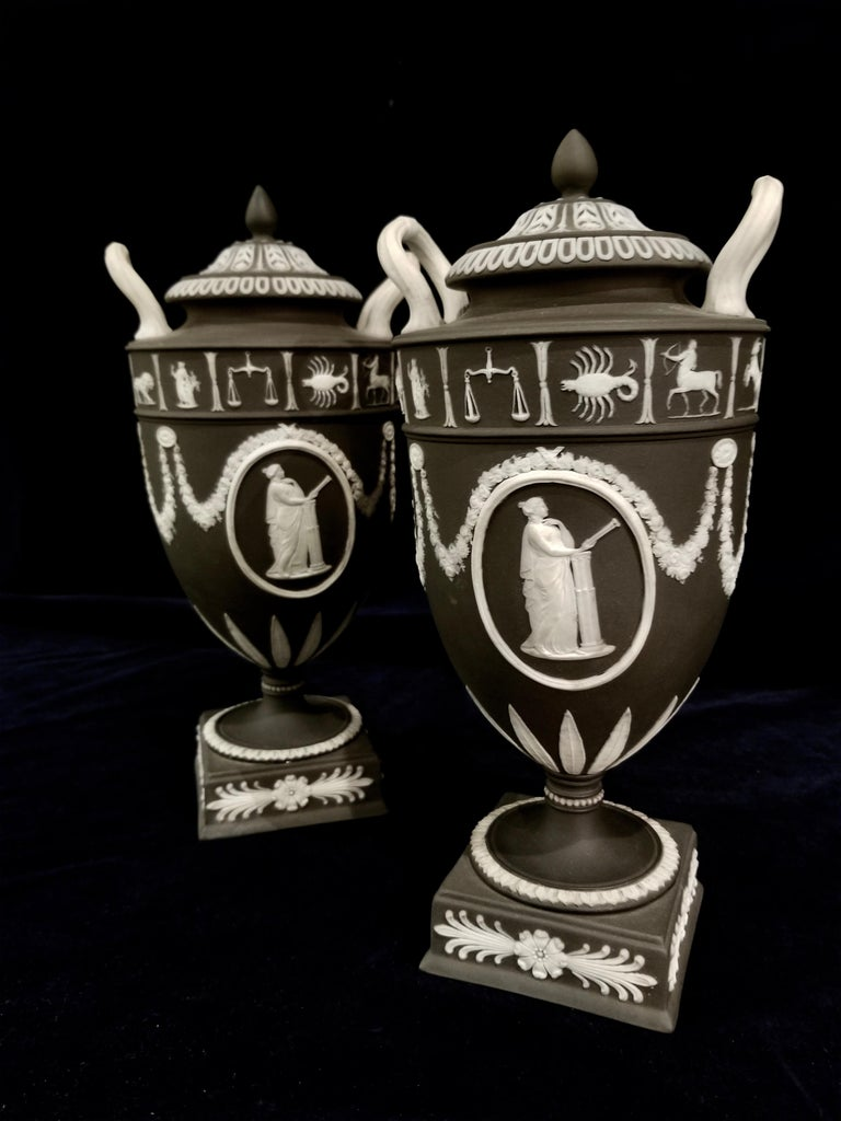 Hand-Carved Pair of English Jasperware Lidded Black-Ground Wedgwood Vases with Zodiac Panels For Sale