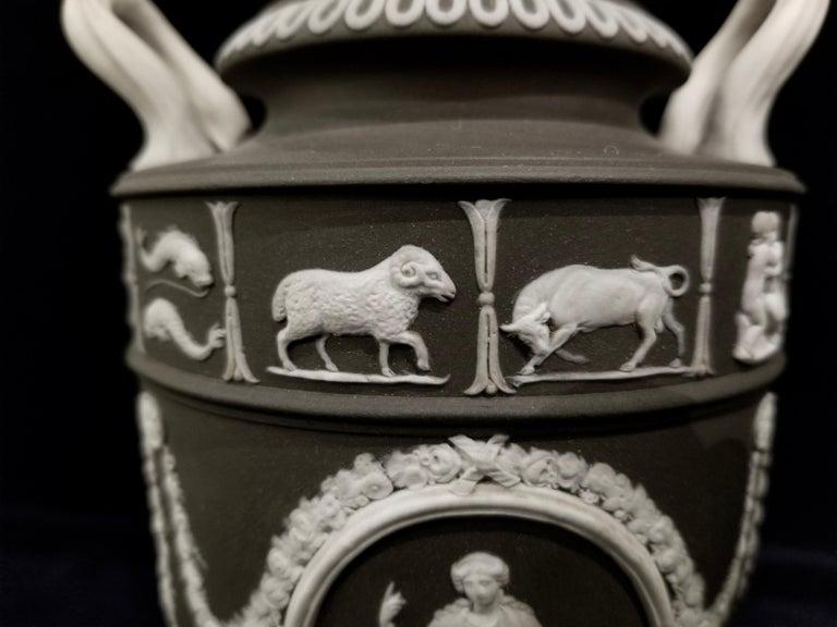 Ceramic Pair of English Jasperware Lidded Black-Ground Wedgwood Vases with Zodiac Panels For Sale