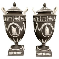 Pair of English Jasperware Lidded Black-Ground Wedgwood Vases with Zodiac Panels