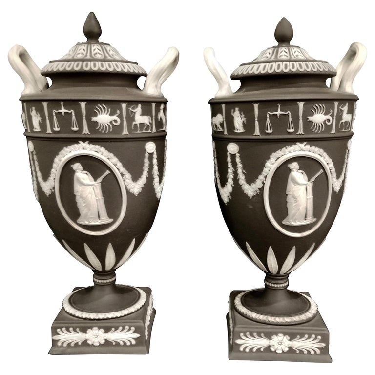 Pair of English Jasperware Lidded Black-Ground Wedgwood Vases with Zodiac Panels For Sale