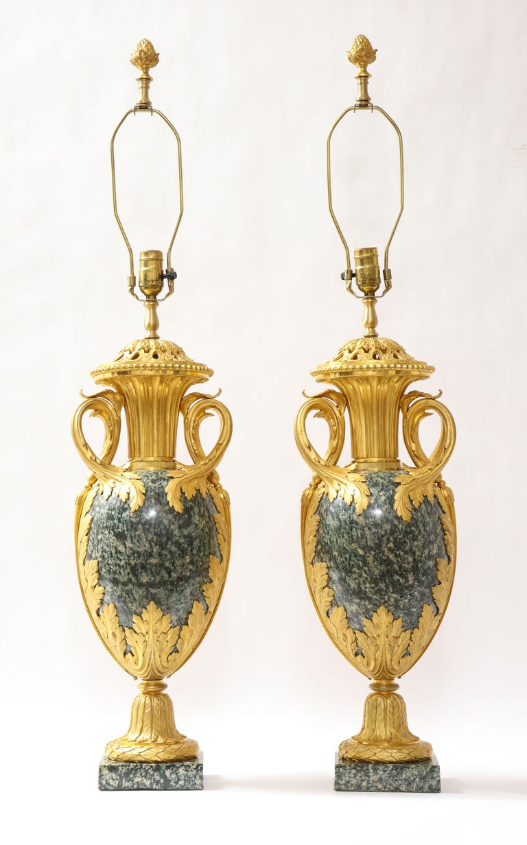 A fantastic and quite large pair of French Louis XVI style dore bronze mounted green marble or possibly Greenish/Grey Porphyry Pot-Pourri vases mounted as lamps, attributed to Henry Dasson. The bronze mounts are fabulously cast, hand-chiseled, and