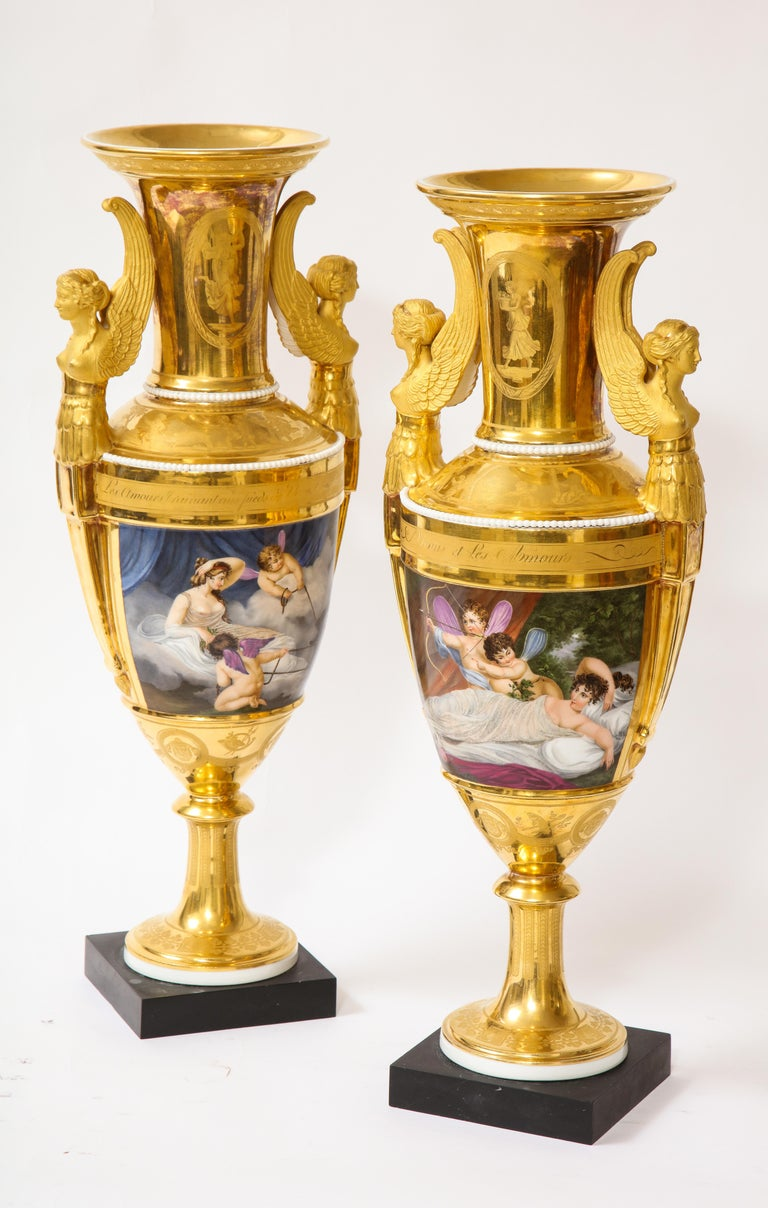 An incredible and rare pair of French Paris Porcelain First-Empire Period Winged Sphynx-form double- handled porcelain vases with mythological scenes of Venus and Cupids after Richard Westall. Of ovoid form, each vase is beautifully hand carved and
