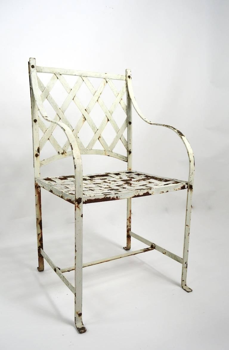 Stylish pair of neoclassical garden or patio armchairs, in old paint finish. Very nice style, design and construction, both show cosmetic wear, normal and consistent with age. Measures: Arm H 27.5 Seat H 18. Priced and selling as a pair, use as is,