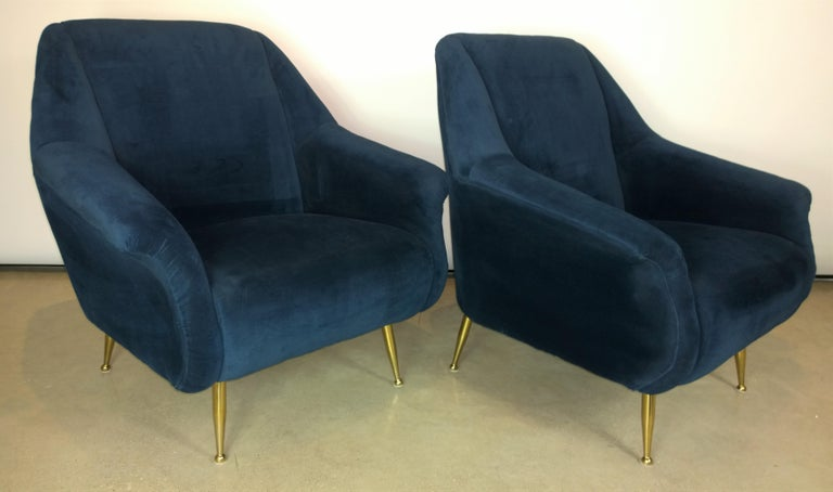 Offered is a pair of Mid-Century Modern Italian Marco Zanuso style navy velvet and new brass legs lounge or armchairs. The navy blue velvet is quite a luxe update to the chairs along with new shiny brass legs. We purchased the chairs already