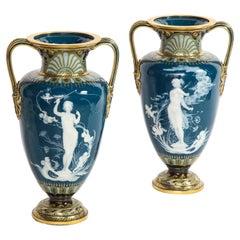 Pr. Mintons Pâte-Sur-Pâte Blue-Ground Vases, 'Too Fast' & 'Too Slow', L. Solon