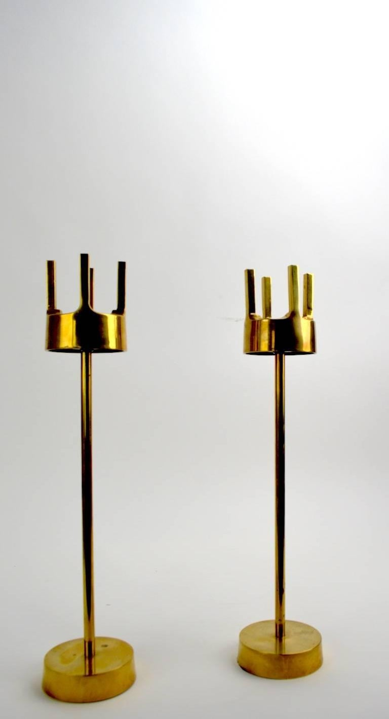 Nice tall pair of midcentury brass candle holders in the style of Pierre Forsell, for Skultuna, unsigned. Clean original condition showing only minor cosmetic wear, normal and consistent with age.