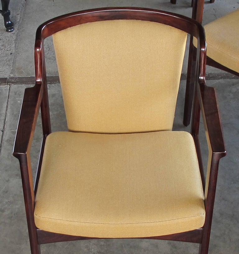 Mid-20th Century Pair of Danish Modern Rosewood Arm Chairs in the Manner of Kai Kristiansen For Sale