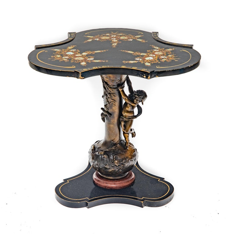Pair of Louis and Francois Moreau signed Art Nouveau bronze based occasional tables. The wooden top is hand painted, inlaid and ebonized. Dimensions: 18