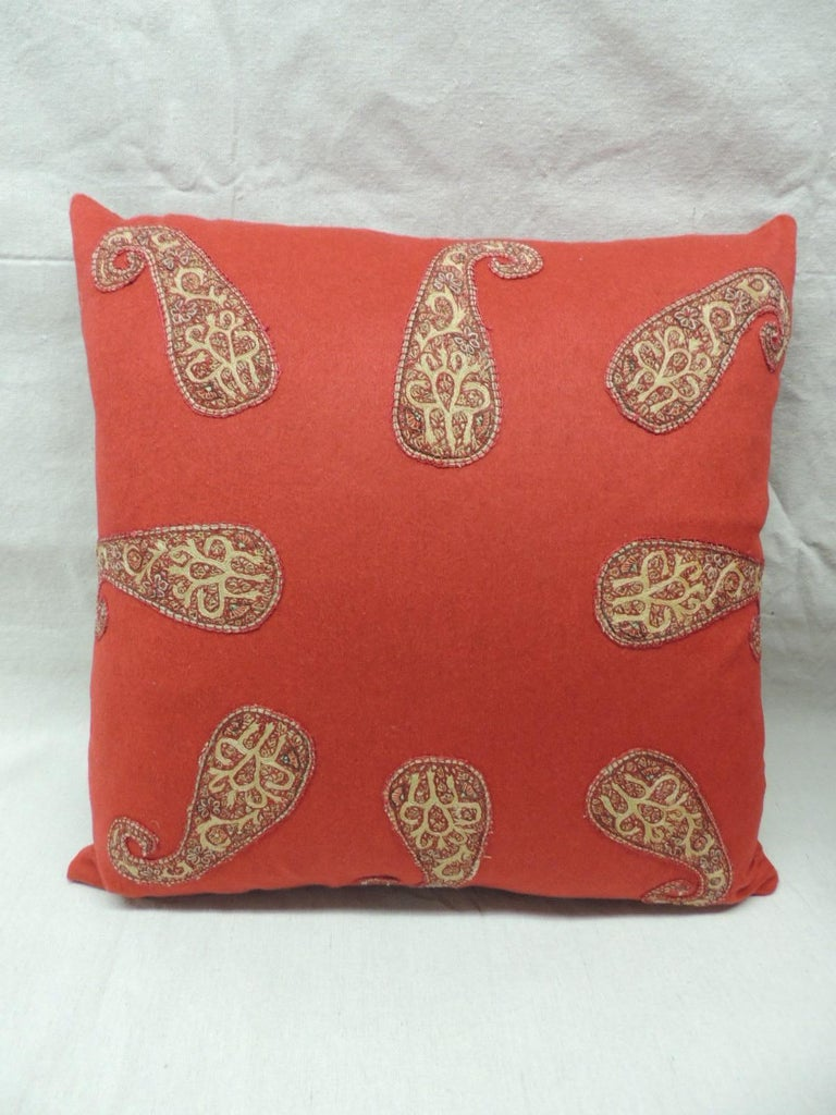 Pair of red Persian paisley hand-applique embroidered paisleys onto a red wool carriage cloth textile. Throw pillows finished with a small Rubelli silk velvet backings. Pillows handmade and designed in the USA. Closure by stitch (no zipper) with