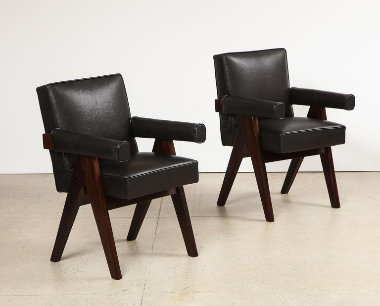 Pair of Senat Armchairs by Pierre Jeanneret.  Dark-stained teak, leather. Produced for the High Court Legislative Assembly, Chandigarh, India. Recently re-upholstered.