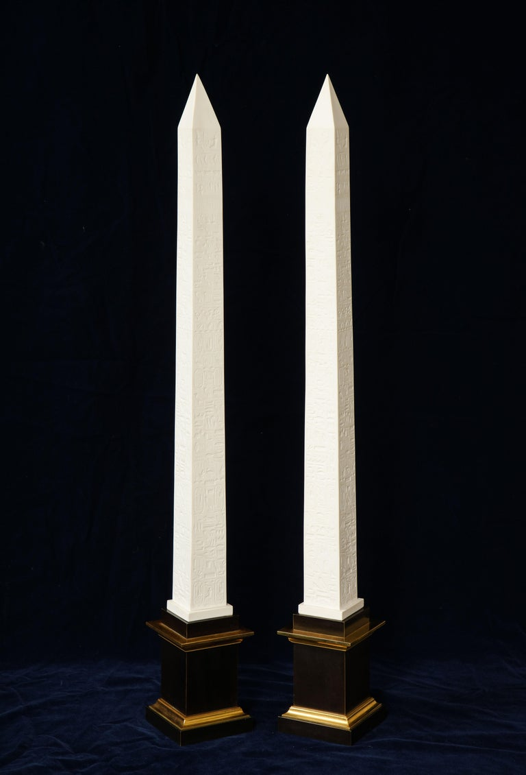 A fabulous and quite unusual pair of original signed and marked Sevres Porcelain patinated and gilt bronze mounted Egyptian Inspired Hyroglifics biscuit Porcelain obelisks. These are truly an amazing pair of Sevres biscuit Porcelain obelisks. It is