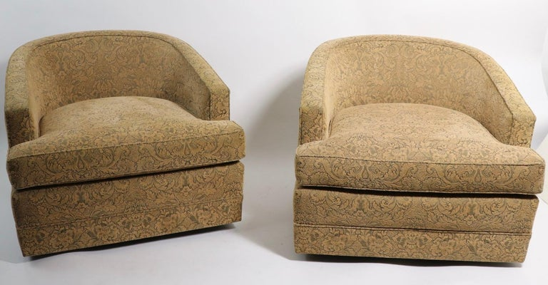 High quality pair of swivel tub chairs in chenille damask fabric. Sleek low slung profile, simple lines will look great in both modern and traditional interior spaces. The chairs are in very good, original condition, clean and ready to use as is or
