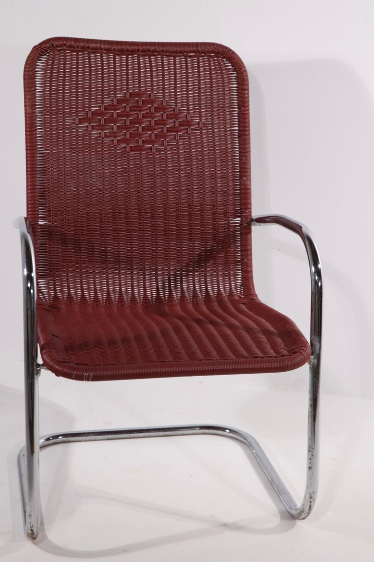 Mid-Century Modern Pr. Tubular Chrome and Woven Plastic Cantilevered Lounge Chairs For Sale