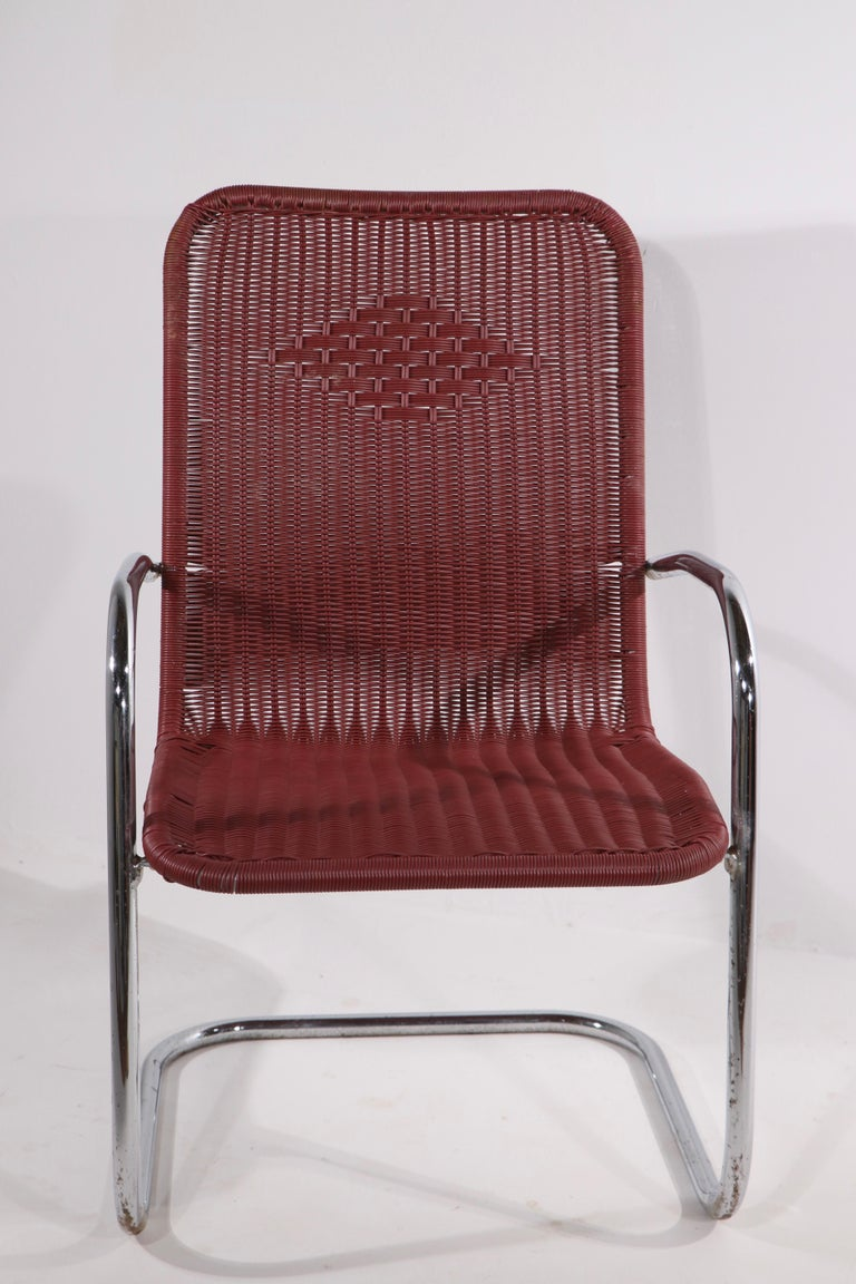 American Pr. Tubular Chrome and Woven Plastic Cantilevered Lounge Chairs For Sale