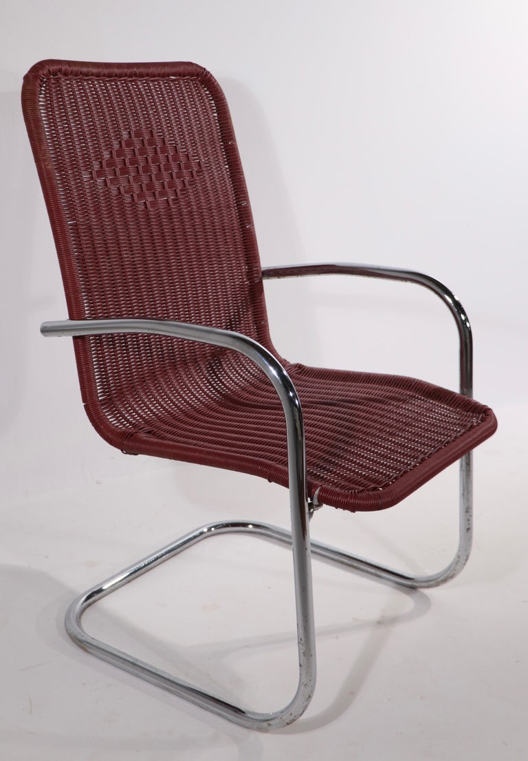 Pr. Tubular Chrome and Woven Plastic Cantilevered Lounge Chairs In Good Condition For Sale In New York, NY