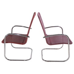 Pr. Tubular Chrome and Woven Plastic Cantilevered Lounge Chairs