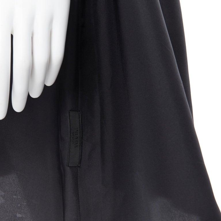 PRADA 2011 100% silk black logo tag pleated collar belted shirt dress IT38 XS Brand: Prada Designer: Miuccia Prada Collection: 2011 Model Name / Style: Silk dress Material: Silk Color: Black Pattern: Solid Closure: Button Extra Detail: Spread