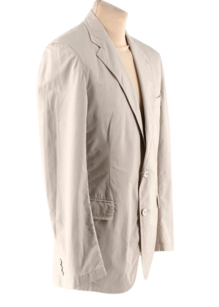 Prada Beige Cotton Single Breasted Blazer Jacket   -Made of soft fresh cotton  -Classic cut  -Gorgeous beige neutral hue  -Button fastening to the front  -Buttoned cuffs  -Vents to the back  -3 pockets to the front  -2 interior pockets  -Timeless